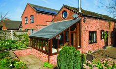 A very cool looking Lean-to conservatory finished with Metrotile Charcoal Black tiles.