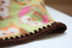 buy fleece and crochet around the edges. Here is a great video tutorial on how to crochet the edge around a fleece blanket.