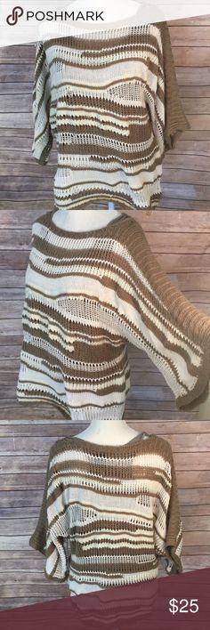 Calvin Klein Jeans knit sweater w/racer back tank Brown and cream tones striped sweater from Calvin Klein Jeans. Built in racerback tank top in a brown tone. Wide half sleeves Calvin Klein Jeans Sweaters Crew & Scoop Necks