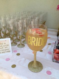 Bridal shower, everyone gets to keep their champagne glass. DIY mod podge the glitter on