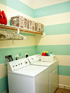 Not ready to fully commit to the contrasting colors look? Start with a favorite color to set the scene of your room and add in accessories of an opposite hue. Accessories can be easily switched out when you're ready to try a new style. Large horizontal stripes of aqua blue and white create interest and excitement in this laundry room, while red accessories contrast with the blue to make the space really pop.