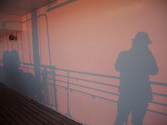 """The shadow of Joji""    Auringonlasku piirsi varjoni laivan kanteen. Olin nyt osa laivaa.    59°57'47.8""N 19°44'47.4""E | Sundeck, Silja Symphony    Kuva: Joji Shimamoto, Tokio"
