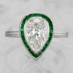 Beautiful halo design.  Rubies and most any other diamond cut would look amazing in this style.  diamond engagement ring with emerald halo