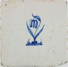 Antique Dutch Delft tile with a tulip in blue, 17th century