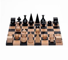 A lifelong friendship with fellow chess enthusiast Marcel Duchamp inspired Man Ray to create his unique chess set in 1920. In his set, Man Ray offers a personal interpretation of each character on the chess board: an Egyptian pyramid for the King, a medieval headdress for the Queen, a flask for the Bishop and the carved scroll of a violin for the Knight. Each beech wood character is rendered in sculptural, geometric forms. $590 at Dwell Store.