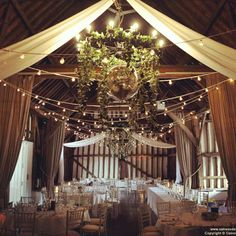 Drapes at the Olde Bell with festoon lights and ivy on the chandeliers for a stylish summer wedding Festoon Lights, Canopy Lights, Ceiling Lights, Wedding Lighting, Four Square, Chandeliers, Summer Wedding, Ivy, The Good Place
