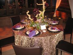 Beautiful table Dinner Décor  Idea he lighting and tablecloth so elegant.