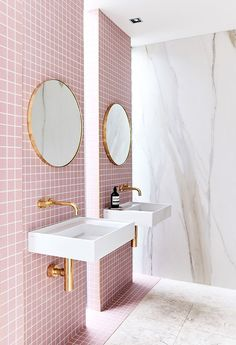 My dream bathroom came to life in Rebecca Judd's home. The square pink tiles selectively line the bathroom creating two stripes for each vanity. The shiny gold