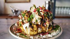 Roasted Cauliflower with Tahina, Halloumi, and Pomegranate Seeds - MUNCHIES