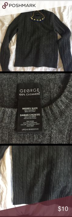 %100 Cashmere sweater. Soft and warm %100 Cashmere!! Lovely grey cable knit sweater. In great condition. Small stretched spot on right wrist (see photo) not noticeable. Minor pilling, nothing a pill remover wouldn't fix. Length 21, chest 16. No trades. Comes dry cleaned. George Sweaters Crew & Scoop Necks