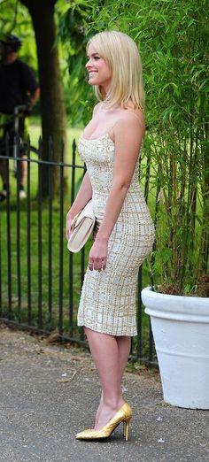 Flattering detailed dress and golden heels on Alice Eve
