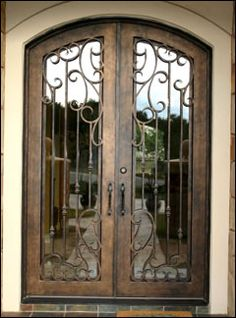 Want a metal arched door with built in glass and then a solid wrought iron gates fences railing wrought bed wood and iron door direct planetlyrics Choice Image