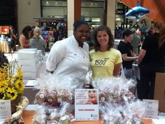 Volunteers passing out baked goods at the Great American Bake Sale at Aventura Mall