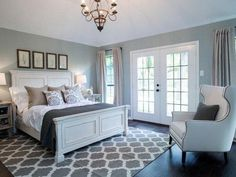 Dusty blue and white master bedroom.