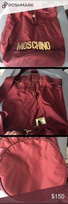 Authentic 90's Moschino bucket bag in burgundy Authentic Moschino burgundy bucket bag with gold hardware. Moschino Bags