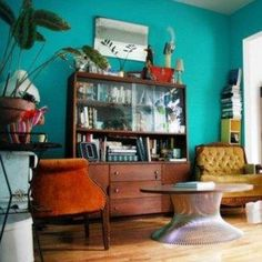 Turquoise Color With Vintage Bookcase With Glass Doors And Drawers And Arm Chairs And Round Coffee Table , Decorating Ideas With Turquoise Color In Furniture Category