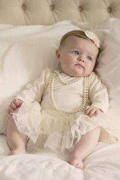 6 month baby girl photos. Clean and classic cream with pearls and tulle. M. Reed Studio