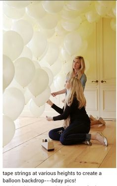 Balloon backdrop with fishing line.  white, clear, gold, ivory? with lace and ribbon matching cake hanging down