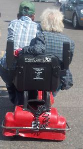 """Little old couple sharing a motorized cart :) yes even a trip to """"Wally World"""" is great with L."""