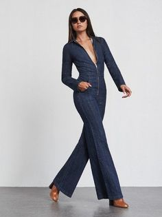 Camino Jumpsuit - a collared, long sleeve denim jumpsuit with a zip front, hip pockets and flare legs. Hugs all the right places (mostly your waist and backside) and the denim has some nice stretch so you get to be comfortable too. Made from deadstock denim.