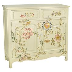 Two-drawer cabinet with a floral motif.   Product: ChestConstruction Material: WoodColor: Cream