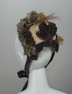 Beige and brown straw bonnet with brown velvet ribbons, artificial ivy leaves, clusters of blueberries and a spray of brown feathers, American (California), Victorian Hats, Victorian Fashion, Victorian Dresses, Vintage Dresses, Vintage Outfits, 1870s Fashion, Bonnet Hat, Millinery Hats, Historical Clothing