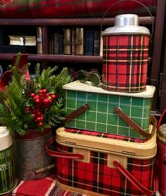 Vintage plaid picnic baskets with plaid blankets and thermos warm up any house at Christmas