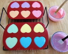 Fill a heart shaped silicone mold with colorful cheesecake filling and turn them into Conversation Heart Cheesecakes.