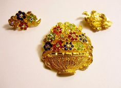 Regency Style~Beautiful Rhinestone Brooch & Clip On Earring Set Lots of beautiful sparkling rhinestones in red, blue, light amber, green, clear. Gold Tone Brooch: 1 & 3/4 H x 1.5 W. Earrings: 1 L x 3/4 W. Cleaning and polishing is left to buyer. Antique, Vintage or used items may have some degree of visible wear or patina. This is considered quite normal and part of overall appeal and charm when buying antique, vintage and pre-owned items. Ships USPS First Class with Tracking & Delivery…