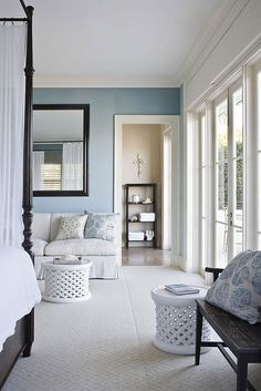 Master retreat with a blue wall as a focal point and great windows that let in a lot of light.
