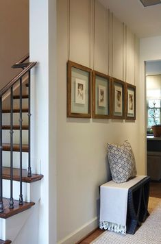 Foyer Picture Display ideas. Foyer Photo Gallery Display. The photos are custom framed (floating frames), and the painted chain came from a hardware store.  Dana Wolter Interiors