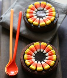 Circle brownies, candy corn circle, ...maybe candy eyeballs in center?