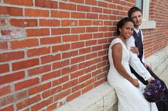 The happy couple took time to relax against the brick wall of the JC Opera House. Brick Wall, Bride Groom, Opera House, Wedding Photos, Relax, Wedding Photography, In This Moment, Couples, Wedding Dresses