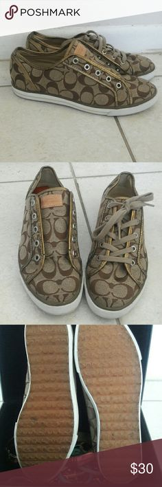 Authentic Womens Coach Shoes Tan and Bronze Coach shoes with white bottom and gum soles. Tan shoe laces. Shoes are in good shape but the shoe lace for right foot went missing after i washed them, and there is VERY small wear on lining (shown in last picture)  Only worn about 7 or 8 times. Priced low because lace missing and scuffs Coach Shoes Sneakers