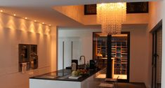 Wenge bespoke wine cellar in kitchen, by Degré 12