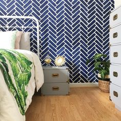 We are swooning over Catherine Evans' inviting guest bedroom featuring a Herringbone Brick stenciled accent wall!     Buy the stencil here: http://www.cuttingedgestencils.com/herringbone-brick-pattern-stencil-wall-decor.html
