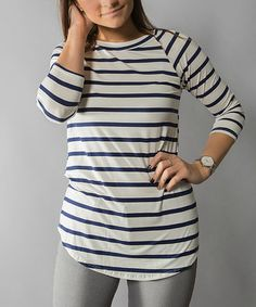 I like the three-quarter sleeves and of course the navy and white stripes.