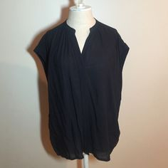 Express blouseSale Black button up short sleeve blouse with deep arm hole cut outs. Would be super cute tucked into a pencil skirt Express Tops Blouses