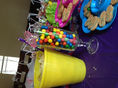 luau decor. buckets for chips or candy on tables