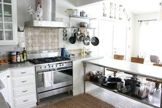 """Commercial kitchen prep as """"peninsula"""". Extend the stainless top 12"""" to make it a counter for stools."""