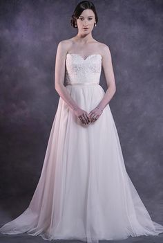 Delustred satin wedding dress with a Chantilly style lace sweetheart bodice featuring a scalloped neckline and a soft tulle skirt. Jacket optional.  Colours available: White, Cream, Caramel/Cream (as shown)