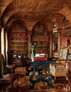 Library ~ Studio Peregalli Renovates Villa Bucciol near Venice, Italy ~ Architectural Digest ~ the library features oak paneling and columned arches ~th table is Tuscan, and the embossed-leather chairs are Louis XVI. Photography by Oberto Gili Beautiful Library, Dream Library, Cozy Library, Library Study Room, Library Chair, Library Shelves, Book Shelves, Library Ideas, Architectural Digest