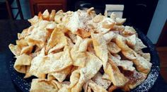 """Chruściki (called also faworki, angel wings) are a traditional sweet crisp pastry made out of dough that has been shaped into thin twisted ribbons, deep-fried and sprinkled with powdered sugar.  Chruściki, chrusty, and faworki are the plural forms of the words chruścik, chrust, and faworek, respectively.  The Polish word """"faworki"""" was the name reserved for colourful ribbons"""