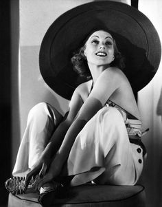 Wide Brim Hats: Ann Sothern in 1936, wearing a wide brim sun hat, beach pajamas, and halter-neck top. There were so many kinds of hats during this time. Most people still wore a hat during the day/night. After 1936 shapes became odd and were influenced by Surrealism. Some different styles of hats include beret, fez, sailors hats, tricorne, and pillbox.