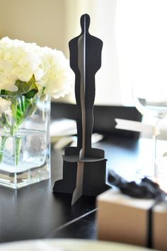 Modern, yet classic take on the Oscars. Black and white are the perfect colors and this party id extremely budget friendly and doable....there are even statuette templates for downlosding! From Twig and Thistle