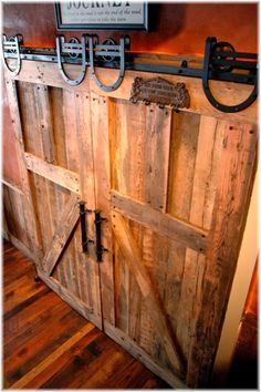 sliding barn doors made with distressed wood. The tracks for barn doors can be found at Ranch Supply stores easily