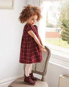 Berry hues and pretty dresses for weekend fun!   Dress: 171525 Boots: 684496. #dress #berry #floral #boots #outfit #cute #kidswear #nextkids #kidsfashion #kidstyle #weekend