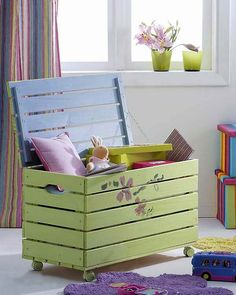 Repurposed pallet into a kids toy box.  Organic kids Products…