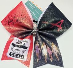 Bows by April - Pretty Little Liars Full Glitter PLL -A Cheer Bow, $15.00 (http://www.bowsbyapril.com/pretty-little-liars-full-glitter-pll-a-cheer-bow/):