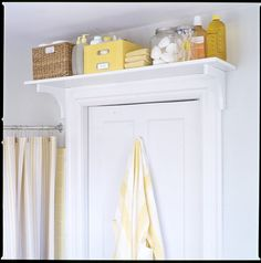 above the door storage for bathroom extras... our bathrooms in the new house are tiny, so this might work really well